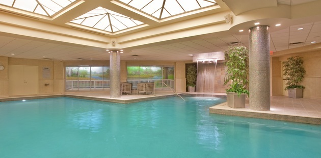 Kalamazoo hotel's indoor pool with a waterfall and columns