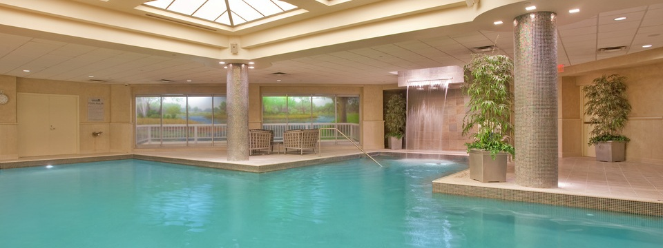 Indoor swimming pool with waterfall