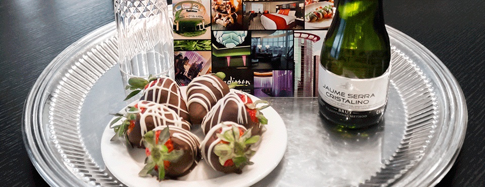 Chocolate-covered strawberries and champagne on silver tray