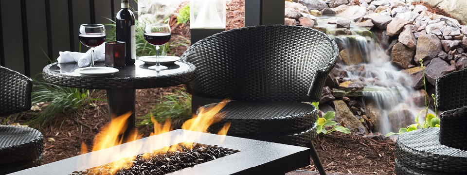 Outdoor dining next to patio firepit