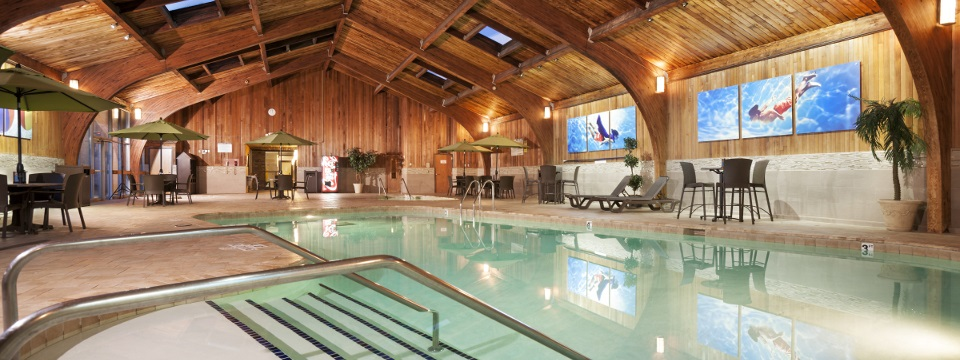 Indoor pool with lounge seating at our Roseville hotel