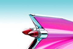 Tail light of hot pink classic car