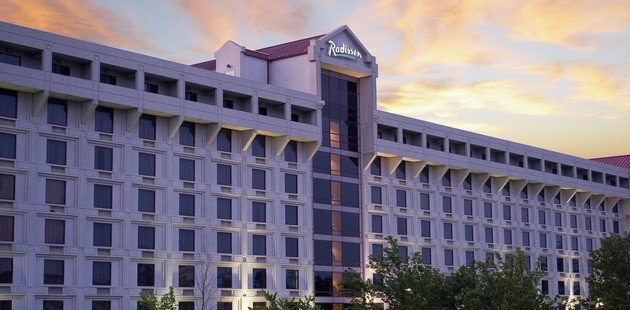 Radisson Hotel Branson beneath colorful clouds