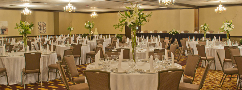 Branson hotel ballroom with banquet setup and white linens