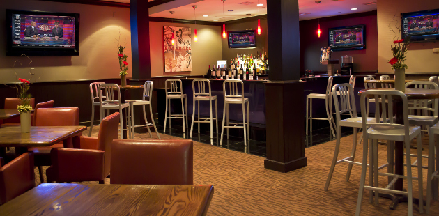 Tables and bar seating at Time Out Sports Lounge in Branson