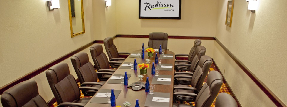 Boardroom with table, chairs and water for each guest