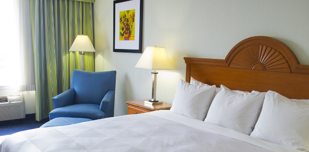 Branson hotel room with king bed and blue armchair