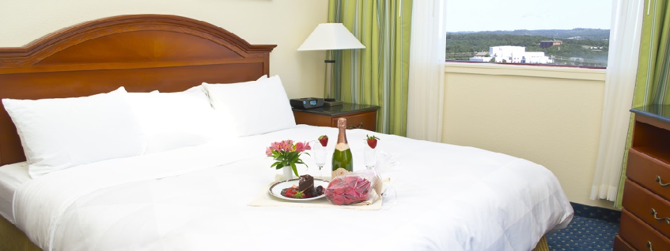 Presidential Suite with a king bed, wine, flowers and views of Branson