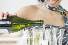 Woman pouring champagne