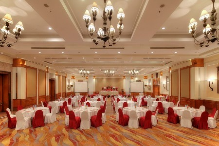 Hotel's Nepa-Dhuku Hall set up with round tables for a banquet