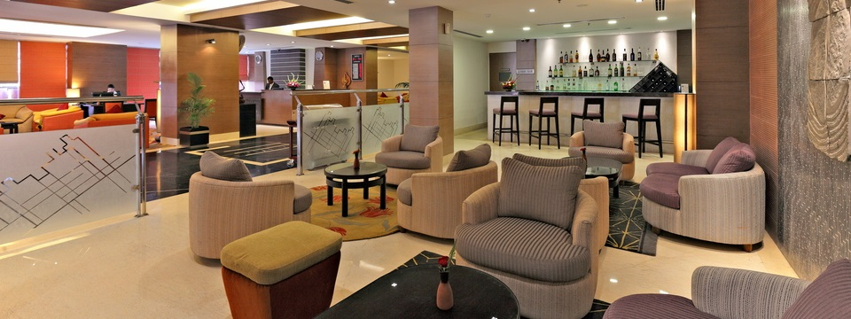 Hotel's lobby bar with plush seating and view of bar counter