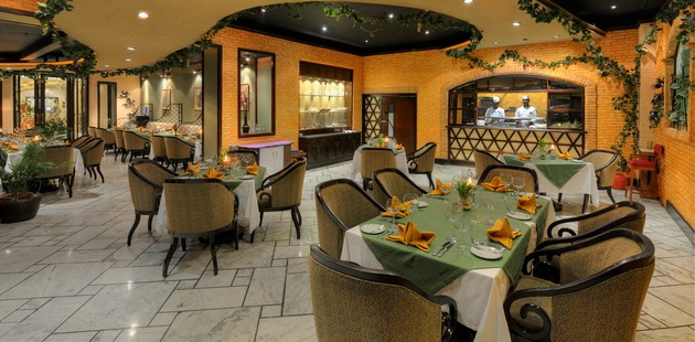 Olive Garden restaurant featuring marble floors and brick walls