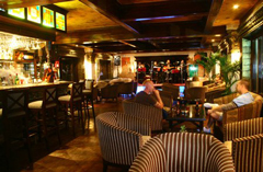 The Corner Bar with plush chairs, bar seating and a live band