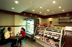 The Pastry Shop with seating and a variety of bakery items