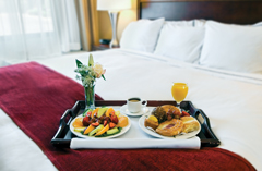 Hotel room with a breakfast tray sitting on the bed