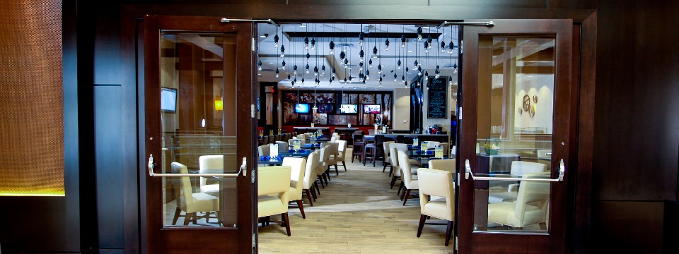 Shade Bar & Grill with white chairs and blue ceiling decorations