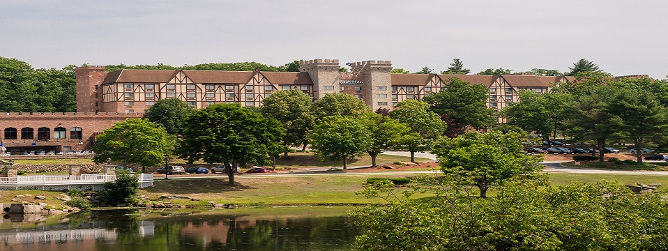 Nashua hotel with castle-like architecture and rows of trees
