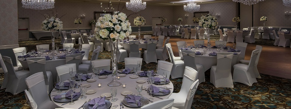 Ballroom decorated with roses and lavender napkins