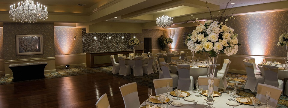 Ballroom with large rose arrangements on each table