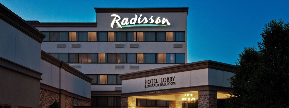 Radisson Hotel Freehold exterior lit up at night