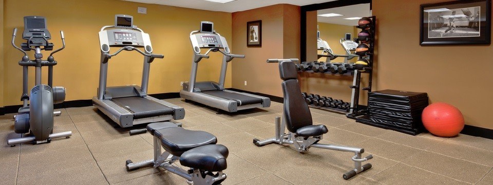 Fitness center with two treadmills, an elliptical and free weights