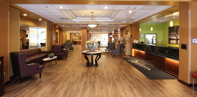 Elegant lobby with comfortable seating and hardwood floors