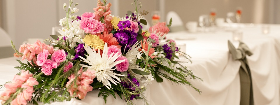 Wedding reception decorated with flower arrangements