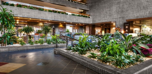 Spacious lobby with greenery in Corning, NY