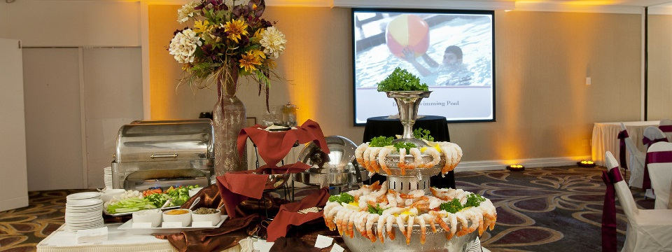 On-site catering featuring a shrimp cocktail display and vegetables