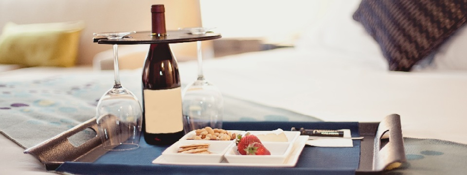Room service tray with wine, glasses and cheese