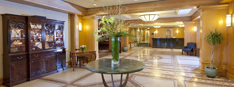 Elegant hotel lobby with large vase on a table
