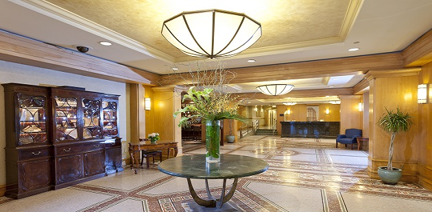 Elegant hotel lobby with granite flooring and bright lighting