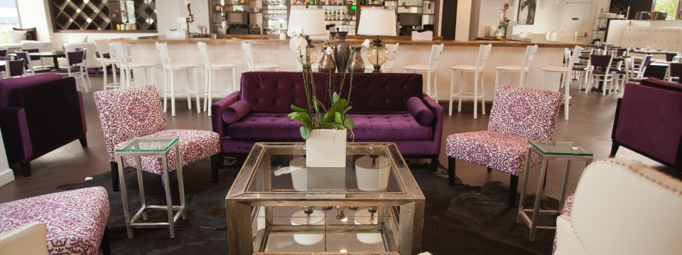 New Rochelle hotel's lounge with bar seating and a sofa