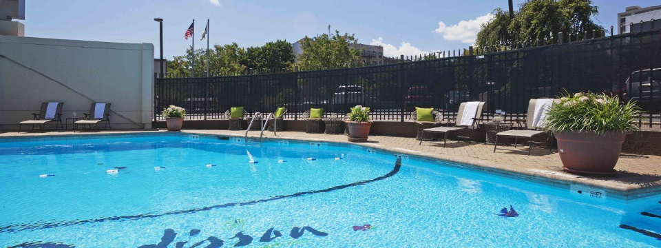 New Rochelle hotel's outdoor pool with lounge chairs