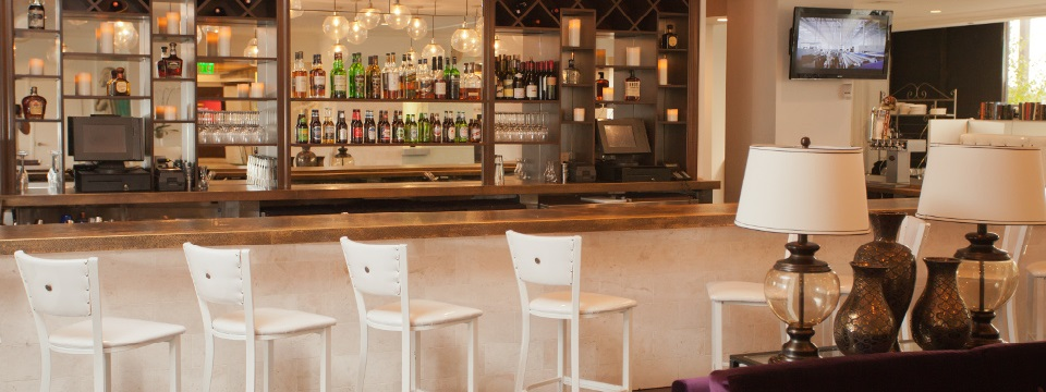 NoMa Social bar with seating and a TV