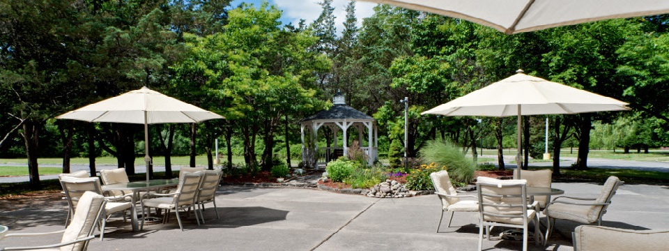 Gazebo and outdoor seating on hotel patio area