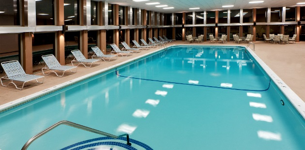 Indoor pool with ample poolside seating