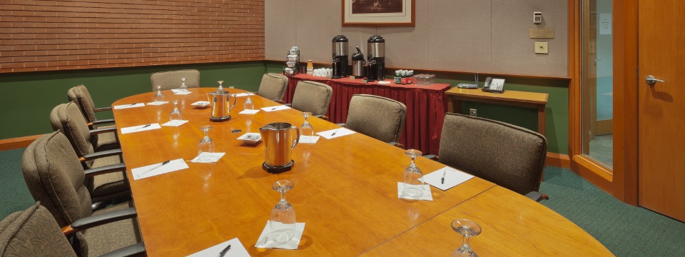 Boardroom with conference table and glassware