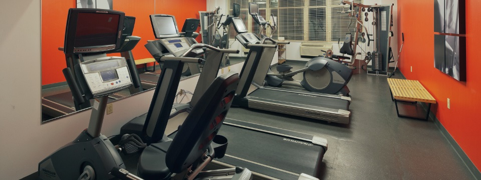 Modern fitness center with treadmills at our Cleveland hotel