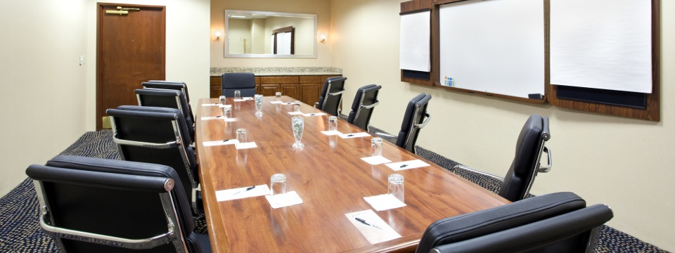 Boardroom conference table, whiteboard and wall charts