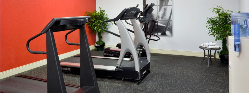 Treadmills and water cooler in fitness center