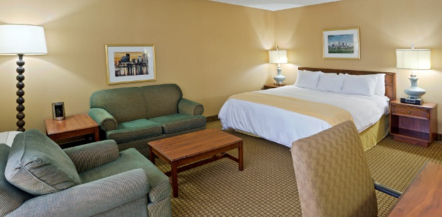 Hotel room with king bed and plush seating