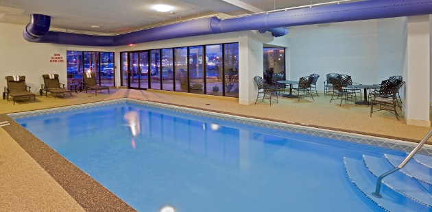 Indoor pool with poolside seating
