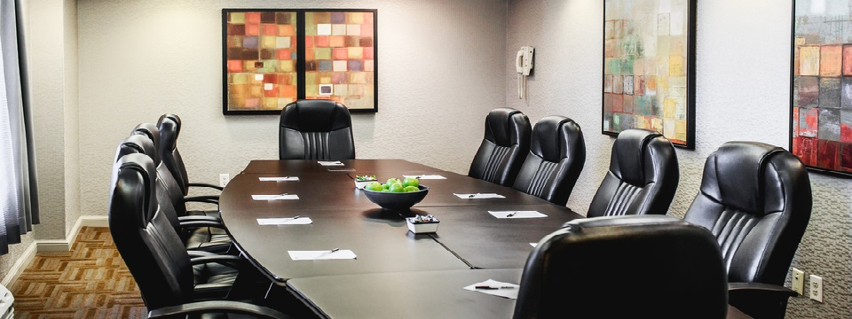 Boardroom with square artwork on the walls