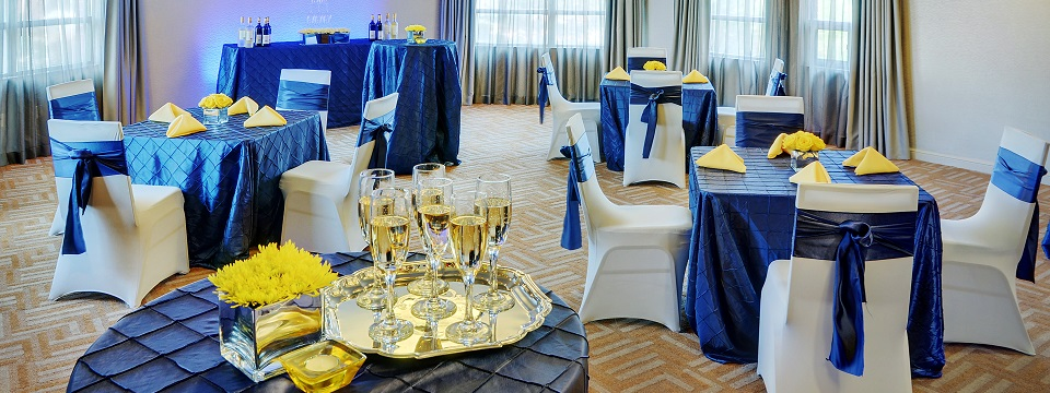 Banquet setup with blue and gold decor
