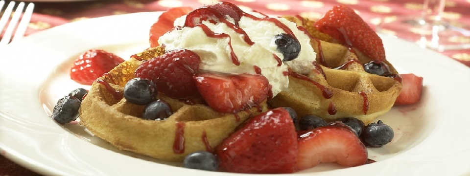 Waffles topped with fresh fruit