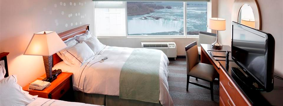 Fallsview hotel room with a flat-screen TV and two beds