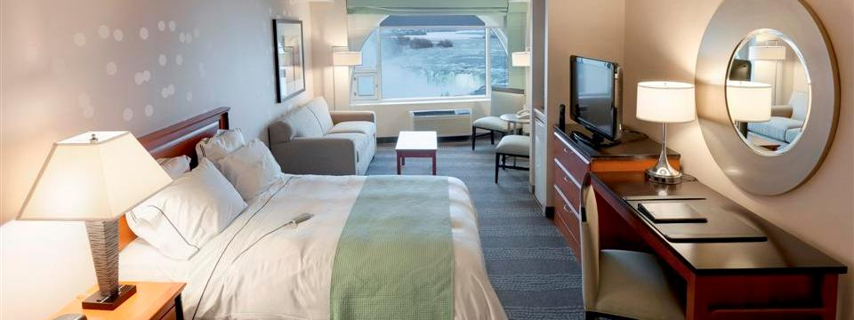 Spacious suite with flat-screen TV and sleeper sofa overlooking Niagara Falls