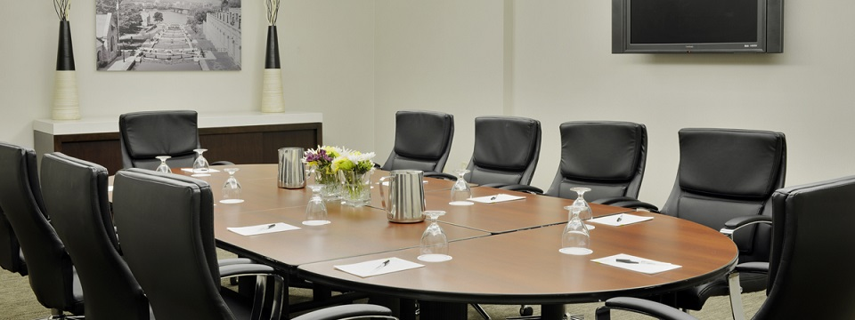 Boardroom with leather chairs and water glasses