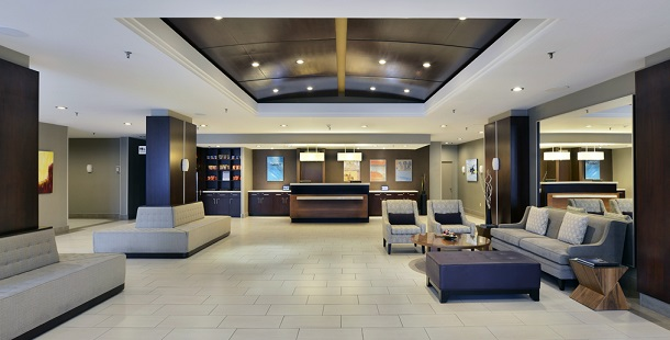 Spacious lobby with modern furniture and reservation desk